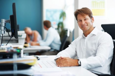 smiling man in office image