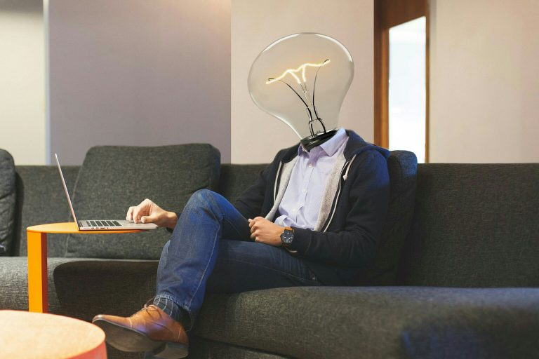 lightbulb idea working laptop