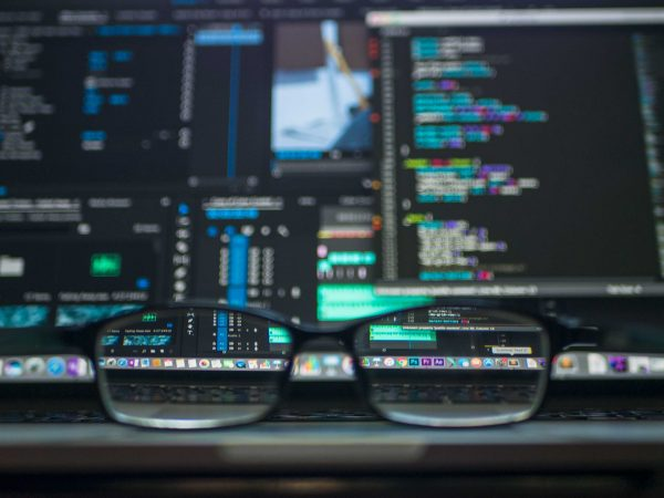reading glasses in front of computer analytics