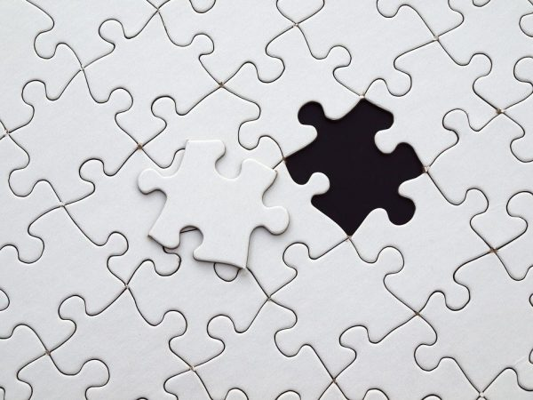 puzzle piece white with black background 960x720