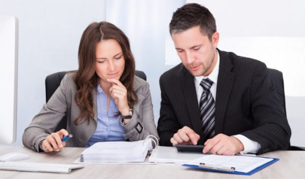 business people calculating finance 700x411