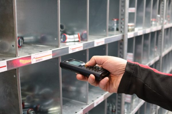person using inventory scanner