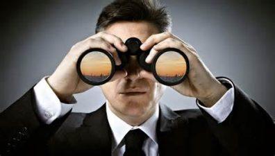 remain vigilant man with binoculars
